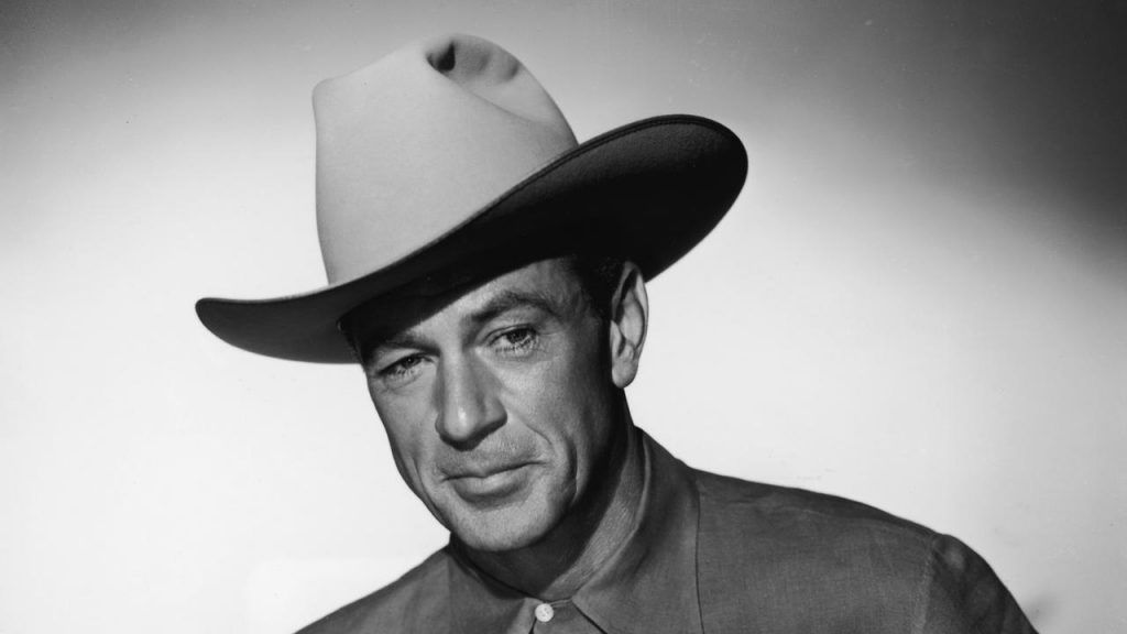 Portrait of American actor Gary Cooper (1901 - 1961), dressed in a cowboy hat and a short-sleeved shirt, 1950s. (Photo by Hulton Archive/Getty Images)