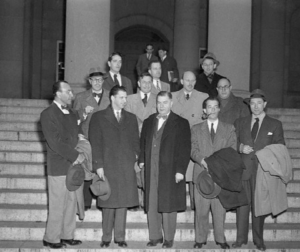 12 Dec 1947, Los Angeles, California, USA --- Cited for Contempt. Los Angeles: Nine of Ten Hollywood writers, directors, and producers cited for contempt of Congress, await fingerprinting in the U.S. Marshall's Office after they surrendered. They are (left to right), Robert Scott, Edward Dmytryk, Samuel Ornitz, Lester Cole, Herbert Biberman, Albert Maltz, Alvah Bessie, John Lawson, and Ring Lardner, Jr. Dalton Trumbo is scheduled to appear shortly. These are the men who refused to state whether or not they are Communists when questioned by the House Un-American Activities Committee in Washington recently. --- Image by © Bettmann/CORBIS